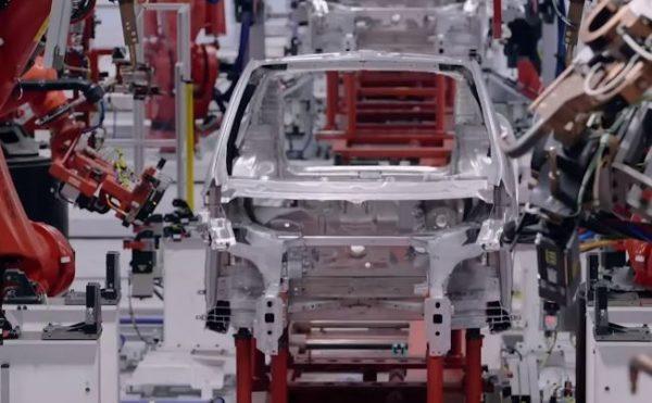 Tesla's KUKA Robots Moving Parts