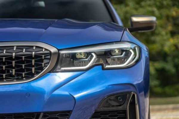 2020 BMW M304i front headlamps close view