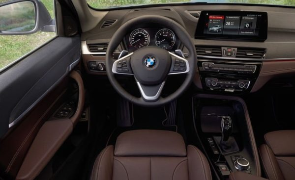 2020 BMW X1 Series infotainment screen steering close view