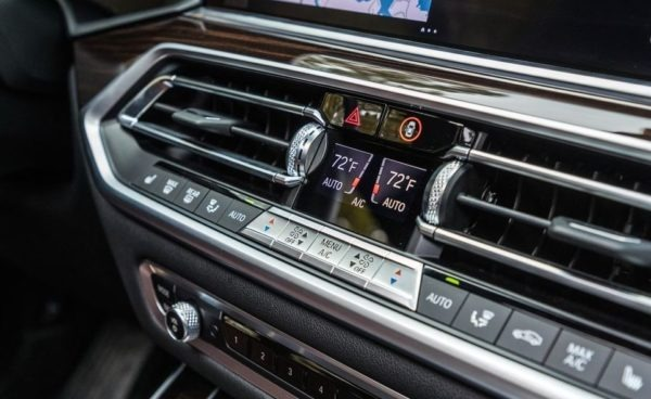 BMW 5 Series xDrive40i air vents and button close view