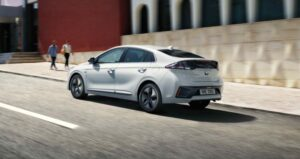 1st Generation Hyundai Ioniq Hybrid sedan side rear view