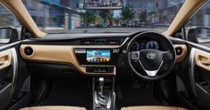 11th generation Toyota corolla Altis Grande sedan front cabin interior view