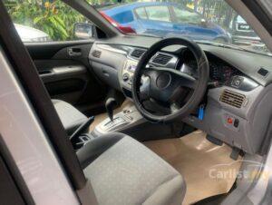 6th generation Mitsubishi Lancer sedan steering wheel and controls view