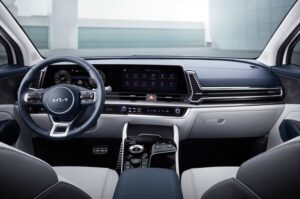 5th generation kia sportage suv steering wheel and infotainment screen view