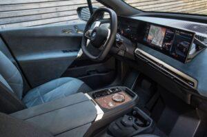 BMW IX Mid Size SUV 1st Generation futuristic front cabin interior technologies