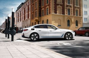 BMW i4 EV 1st generation sedan full side view and charging