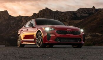 Kia stinger sedan Refreshed 1st generation red front with headlights on