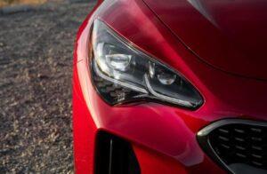 Kia stinger sedan Refreshed 1st generation red headlamp view