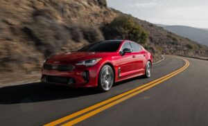 Kia stinger sedan Refreshed 1st generation red on the run view